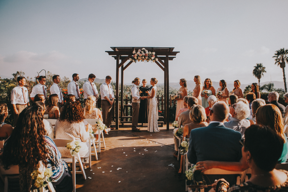 san diego wedding   photographer | crowd in front of bride and groom standing under gate