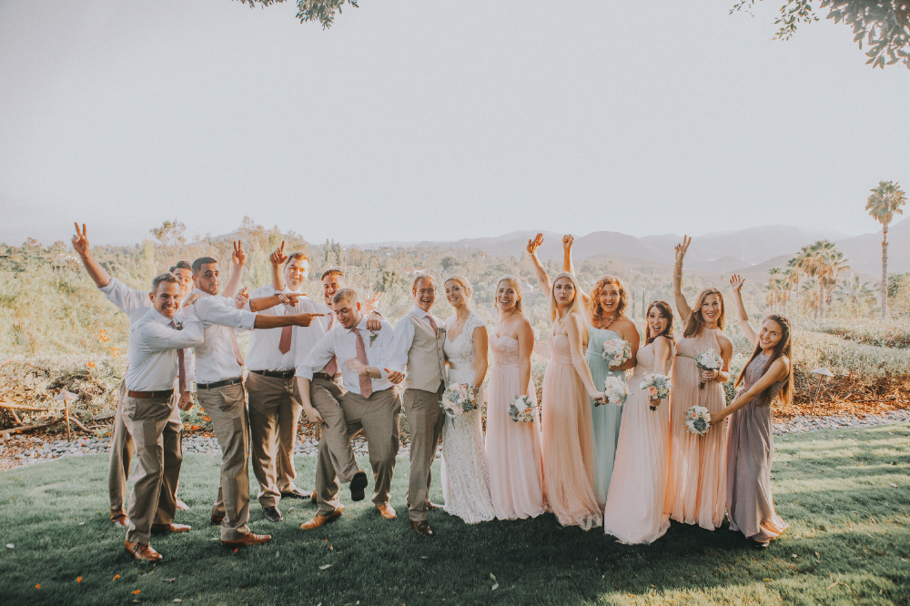 san diego wedding   photographer | lineup of bridesmaids and groomsmen posing for the camera