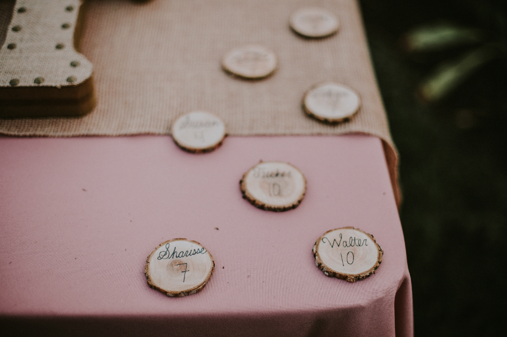 san diego wedding   photographer | wood chips with seat arrangement written on it