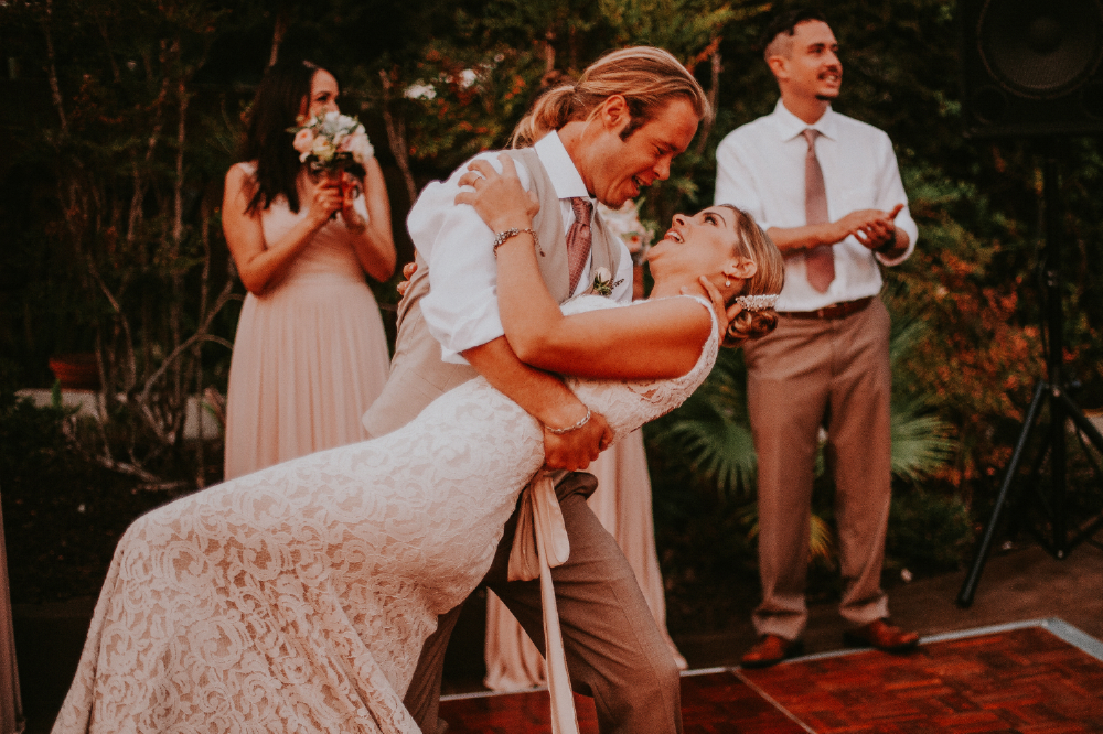 san diego wedding   photographer | groom holding bride leaning about to kiss on dance floor