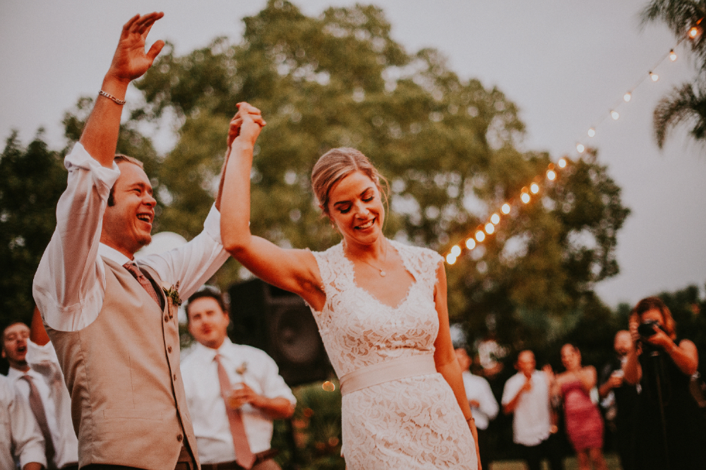san diego wedding   photographer | bride and groom's arm raised on dance floor