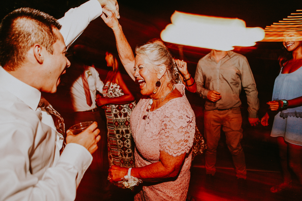 san diego wedding   photographer | middle aged woman dancing with young man on dance floor