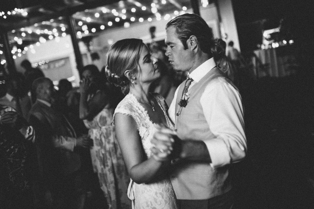 san diego wedding   photographer | monotone shot of bride and groom slow dancing on dance floor
