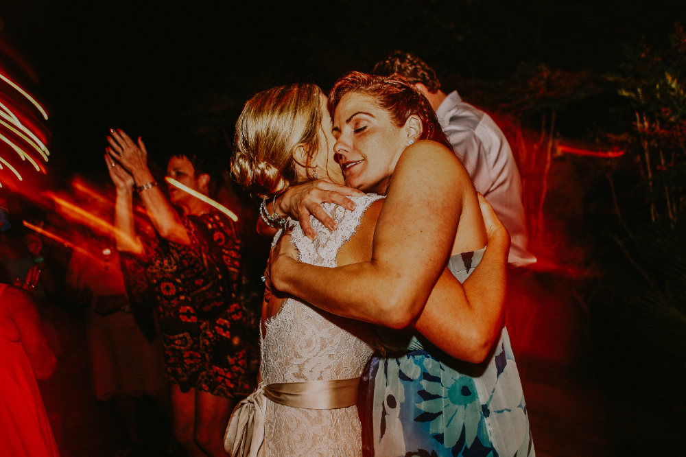 san diego wedding   photographer   high contrast picture of women dancing on dance floor