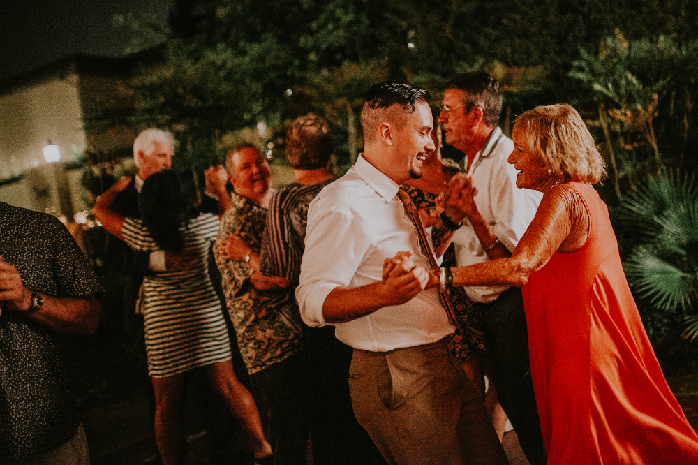 san diego wedding   photographer | man with undercut dancing with middle aged woman in red dress