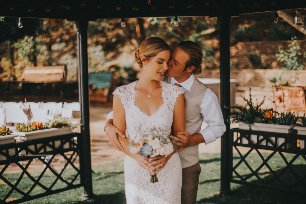 san diego wedding   photographer | bride surprised being kissed by groom in gazebo