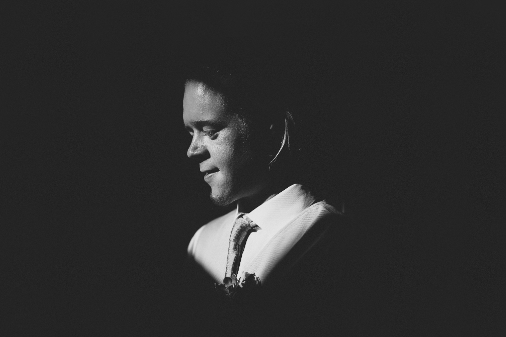 san diego wedding   photographer | monotone shot of man's face illuminated with small light