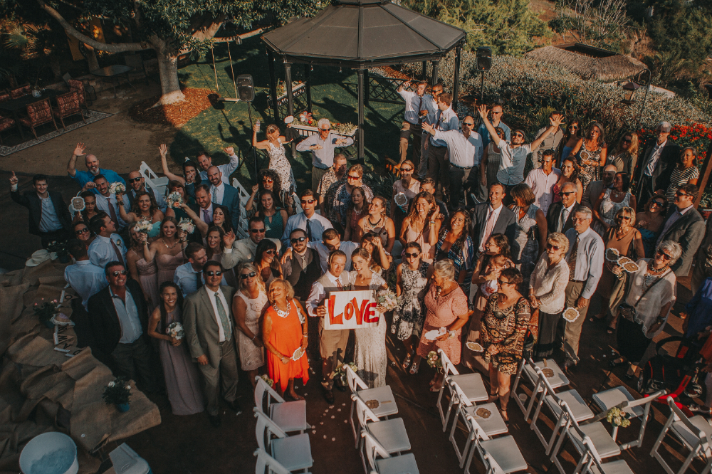 san diego wedding   photographer | crowd looking up at camera from high point smiling