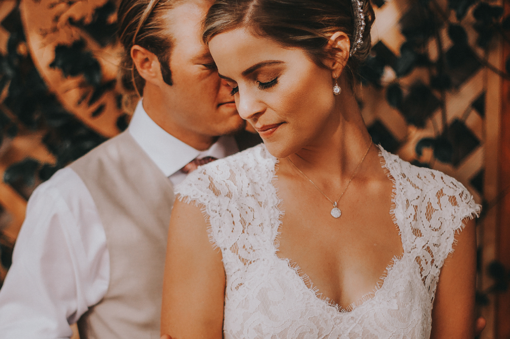 san diego wedding   photographer | groom near bride behind her with bride's eyes closed