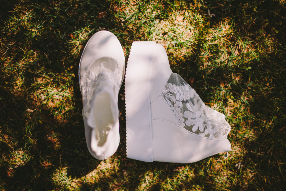 san diego wedding   photographer | white wedding shoes on the ground