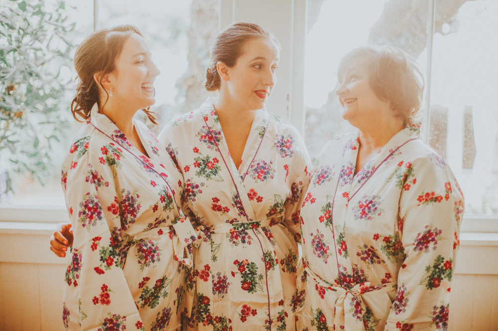 san diego wedding   photographer | bridesmaids in floral robes standing arm in arm