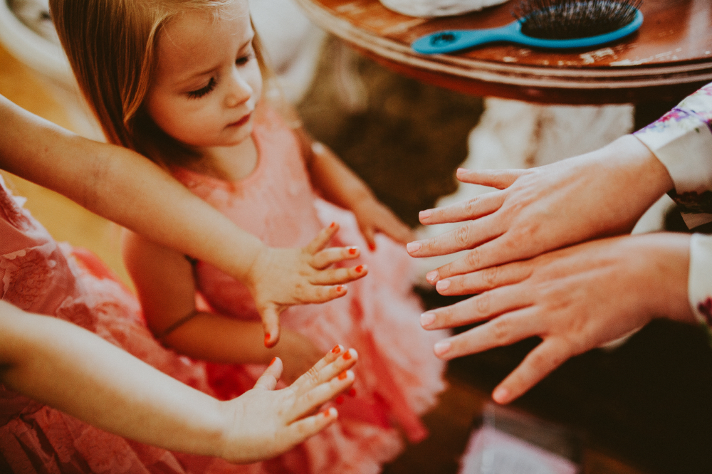 san diego wedding   photographer | child with women's hands with painted nails