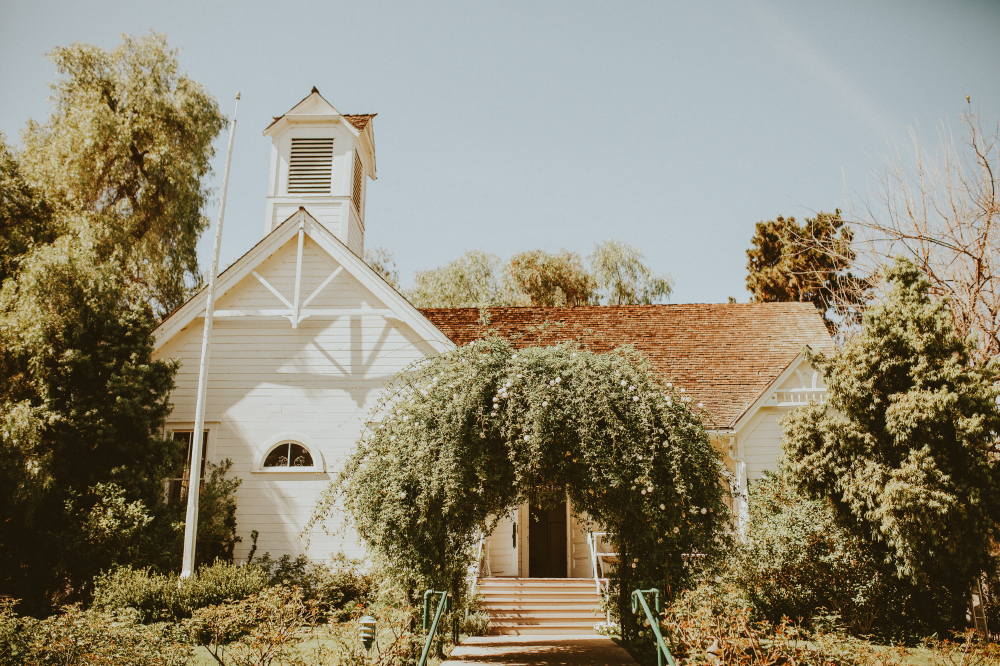 san diego wedding   photographer | front view of house with arch filled with plants