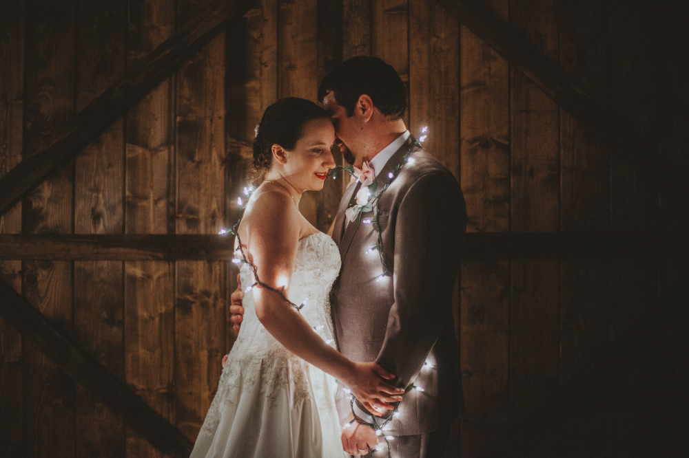 san diego wedding   photographer | newly wed couple surrounded by led lights