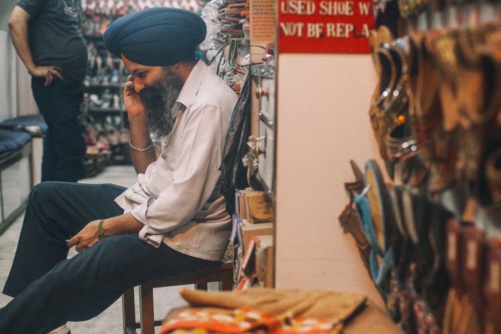 san diego wedding photographer | man in turban sitting down calling on the phone
