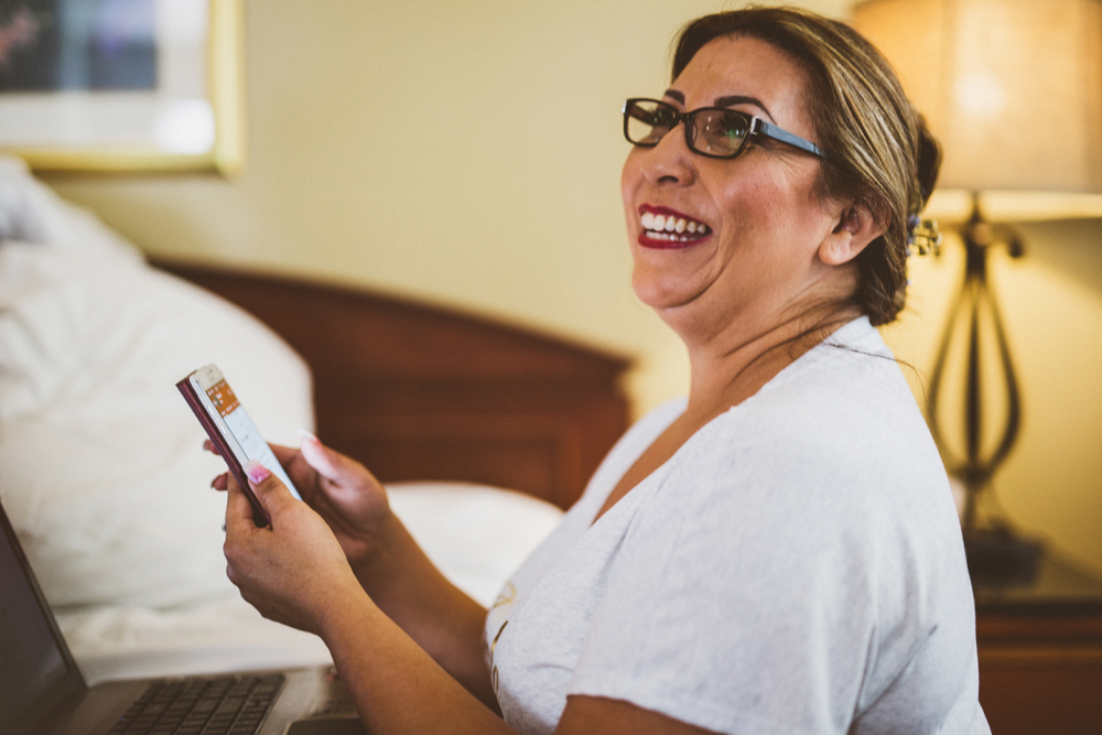 san diego wedding   photographer | bride with glasses and phone looking up smiling