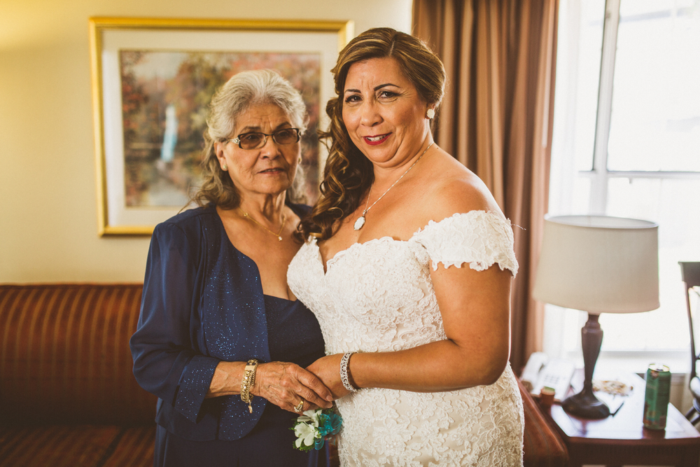 san diego wedding   photographer | bride posing with elderly woman in midnight blue dress