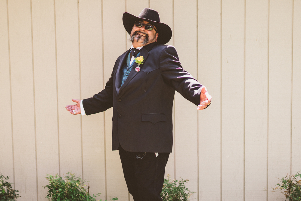 san diego wedding   photographer | groom in suit and cowboy hat posing smiling