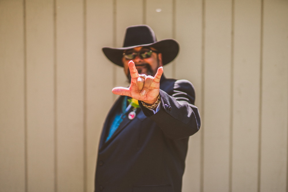 san diego wedding   photographer | groom doing sign of the horns in front of him