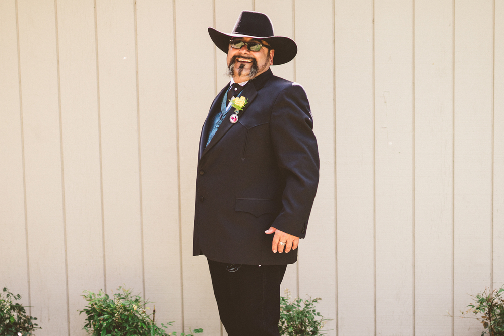 san diego wedding   photographer | groom in suit and cowboy hat standing facing his right