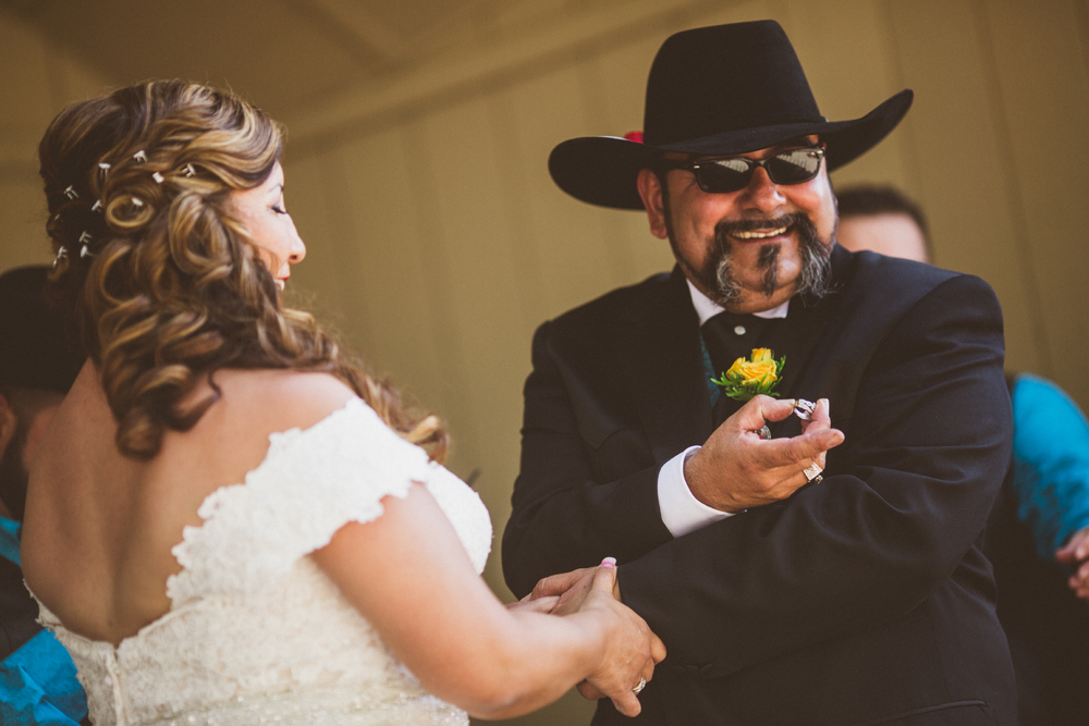 san diego wedding   photographer | groom showing off wedding ring in front of bride