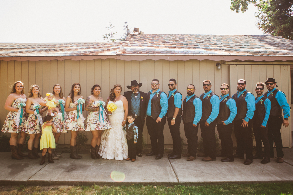 san diego wedding   photographer | lineup of bridesmaids in floral dress and groomsmen in   turquoise