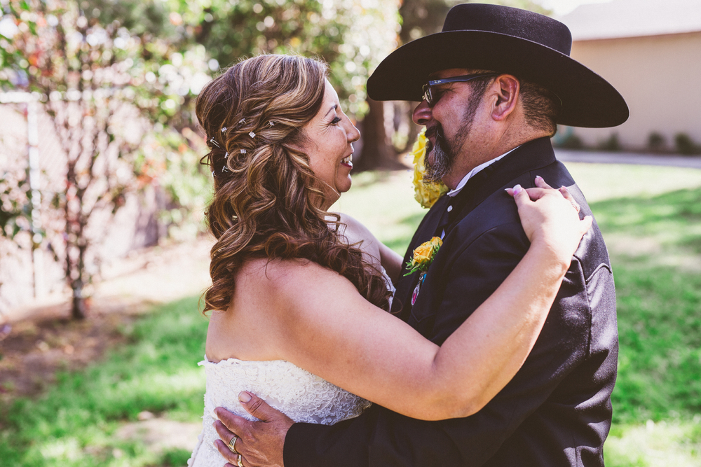 san diego wedding   photographer | bride and groom holding each other and smiling
