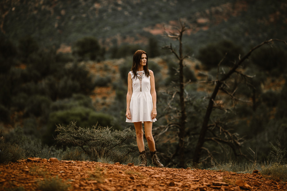 san diego wedding   photographer | woman in whtie in boots with canyon in background