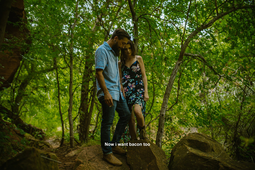 san diego wedding   photographer | bearded man in blue with woman in floral black dress looking   down