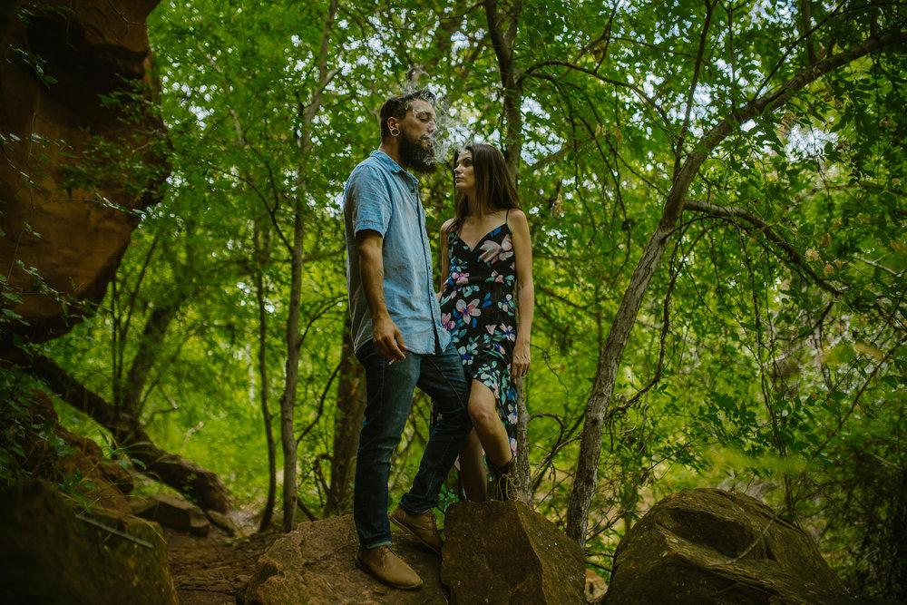 san diego wedding   photographer | bearded man in blue smoking on rock