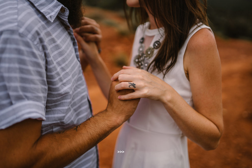san diego wedding   photographer | torso of woman in white holding hands with man in blue