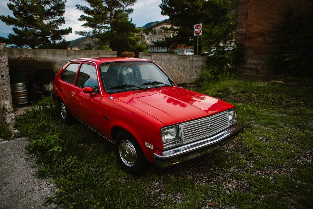 san diego wedding   photographer | red shiny car on yard