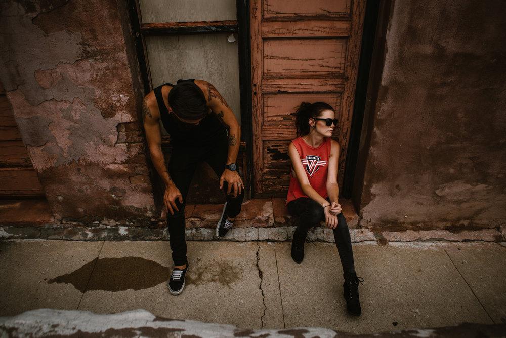 san diego wedding   photographer | couple sitting on doorway with wooden door behind
