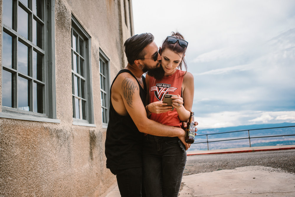san diego wedding   photographer | bearded man holding woman looking at phone