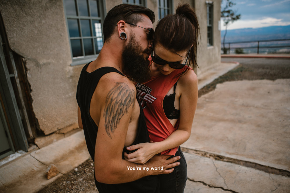 san diego wedding   photographer | bearded man holding woman from front about to kiss side of her   neck
