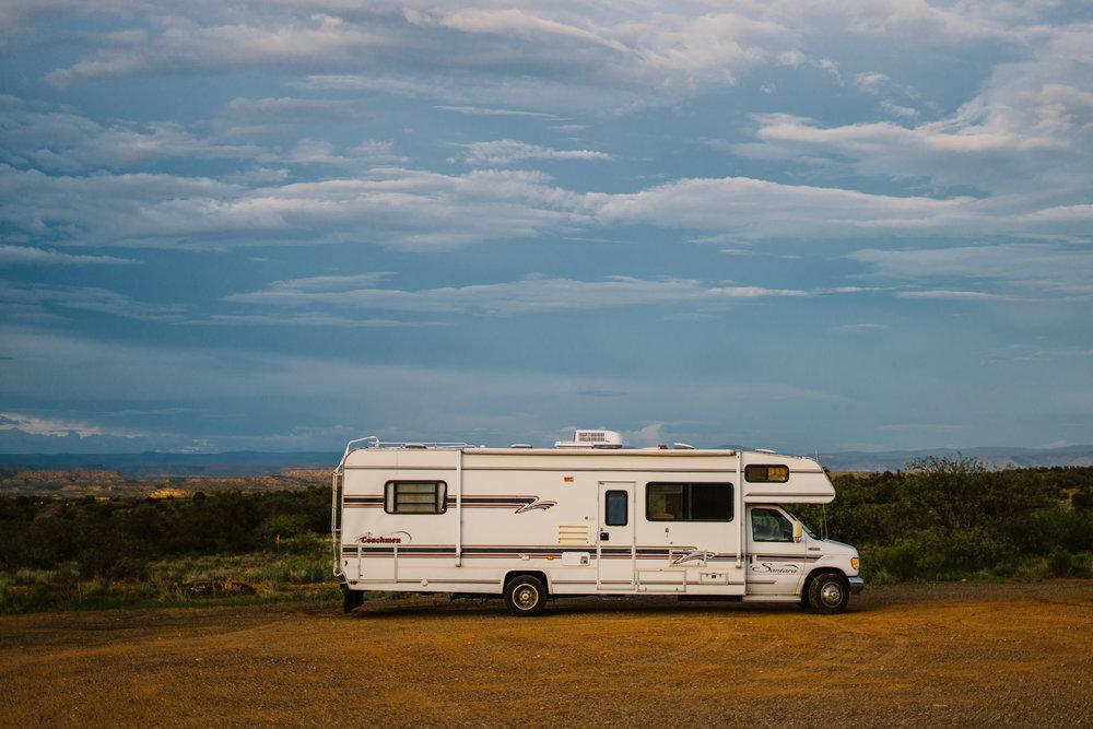 san diego wedding   photographer | white recreational vehicle against canyon background