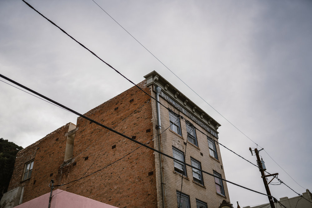 san diego wedding   photographer | bottom view of old brick building against cloudy sky
