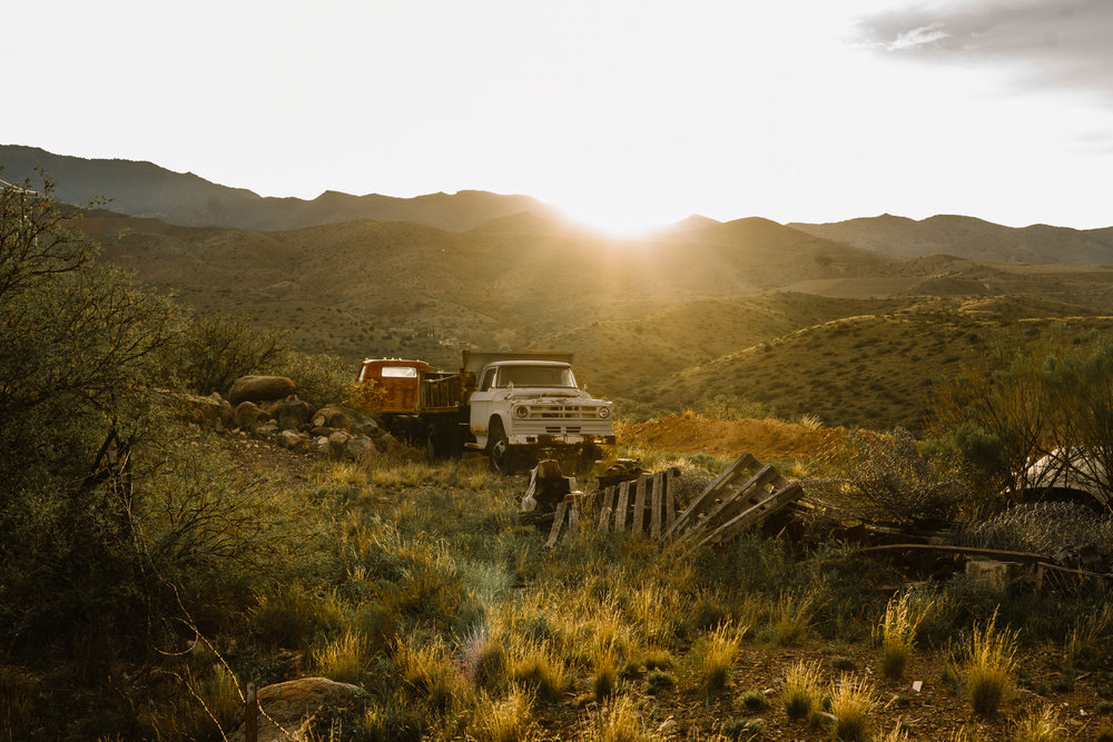 san diego wedding   photographer | old truck in grassy land with sun about to set in background