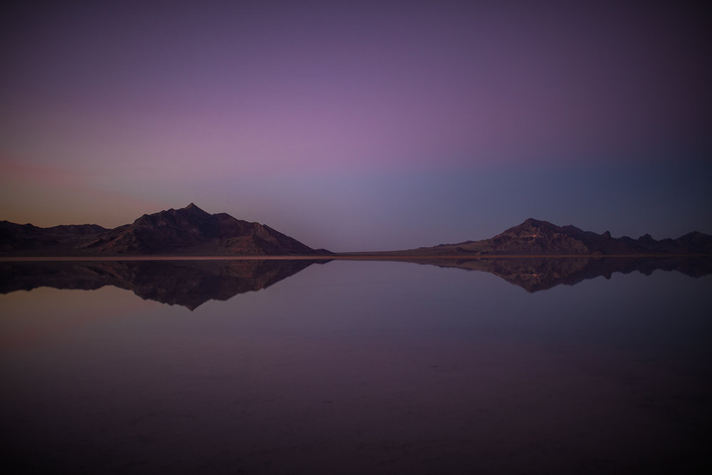 san diego wedding   photographer | bonneville salt flats and purple-blue sky with two mountain   ranges