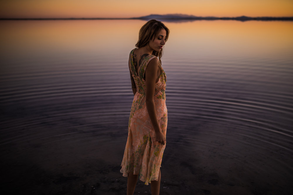 san diego wedding   photographer | woman in floral dress standing on salt flats and looking at   the water