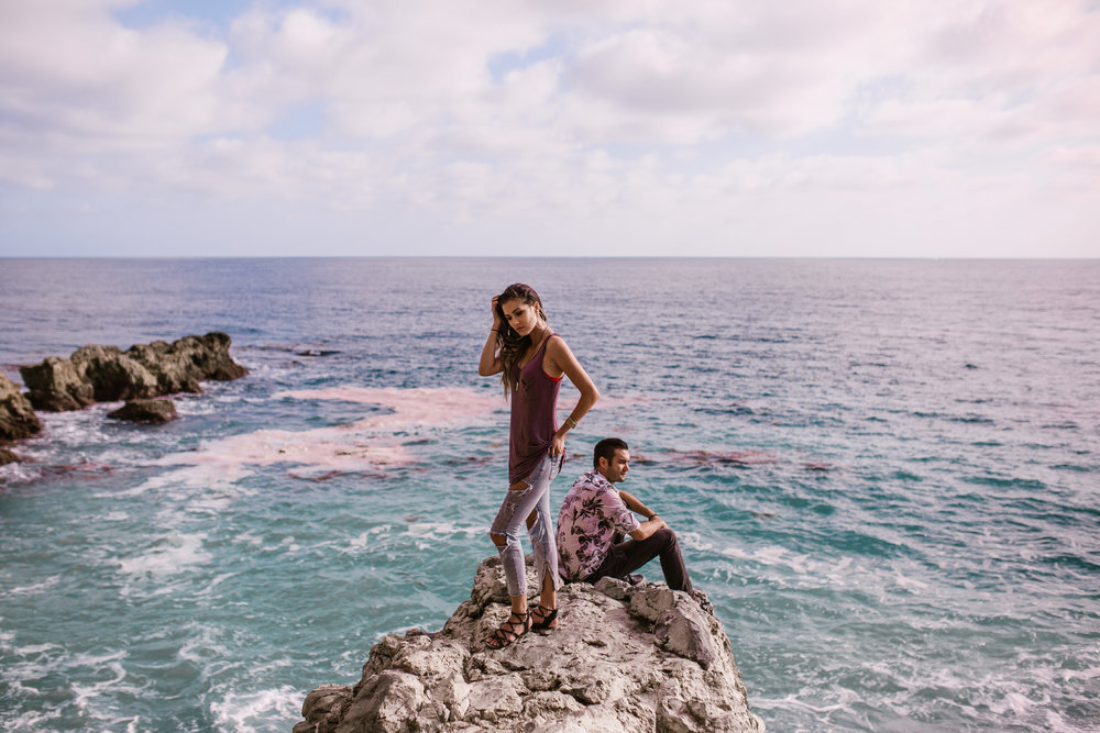 san   diego wedding photographer | woman in ripped jeans with man sitting behind   her