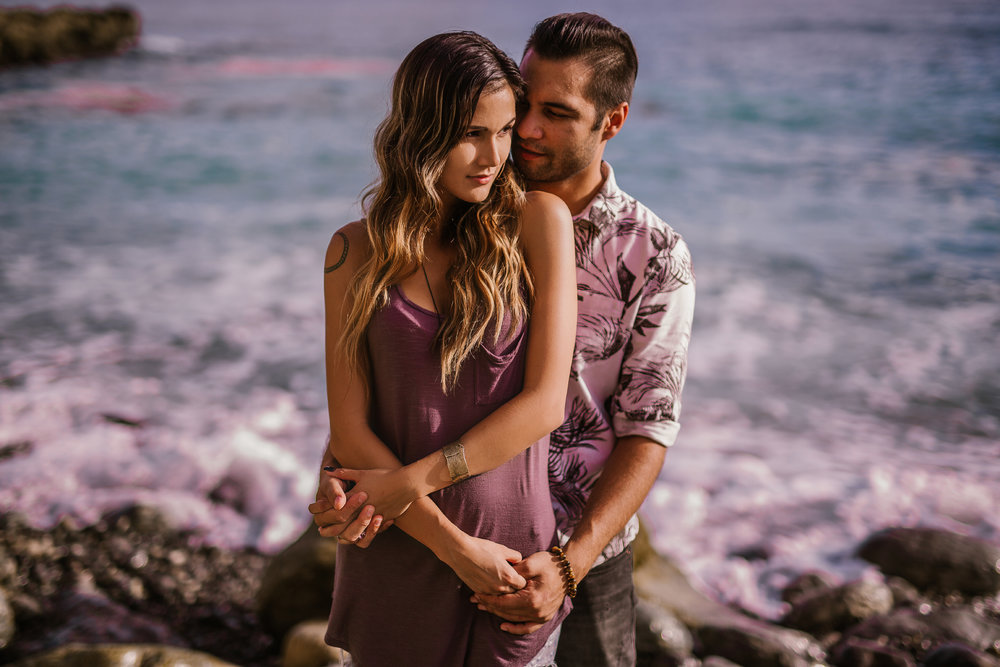 san   diego wedding photographer | man holding woman in faded purple tank top from   behind