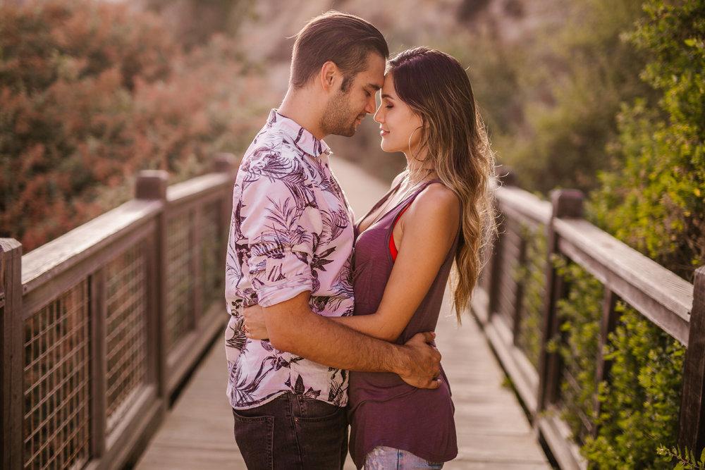 san diego wedding photographer   man about to kiss woman on bridge