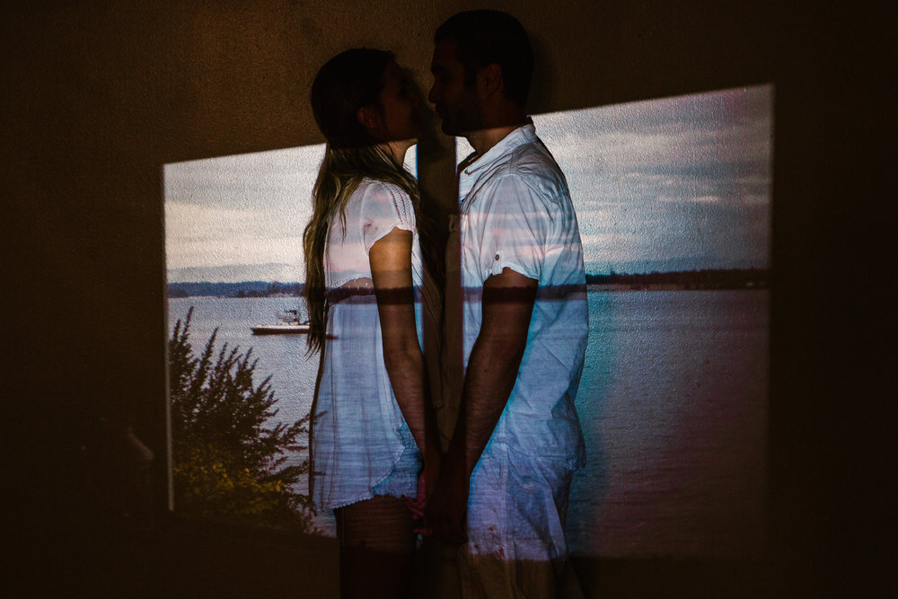 san   diego wedding photographer | couple looking at each other close with sea   projected on them