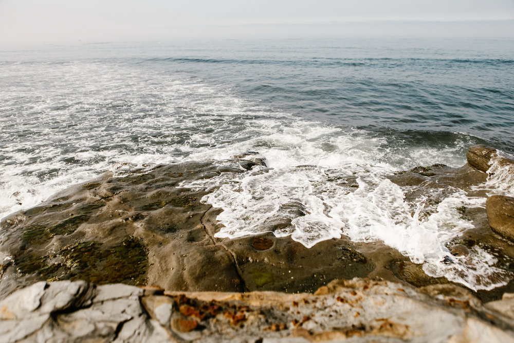 san   diego wedding photographer | wave crashing against rock formation