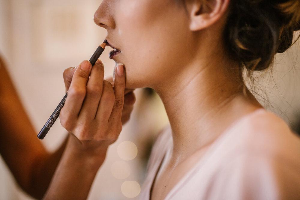 san diego wedding   photographer | woman being applied lipstick on