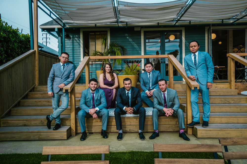san diego wedding   photographer | group of people in wedding attire seated on staircase