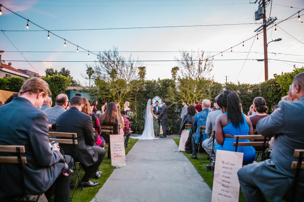 san diego wedding   photographer | bride and groom down the aisle with lighting on wire