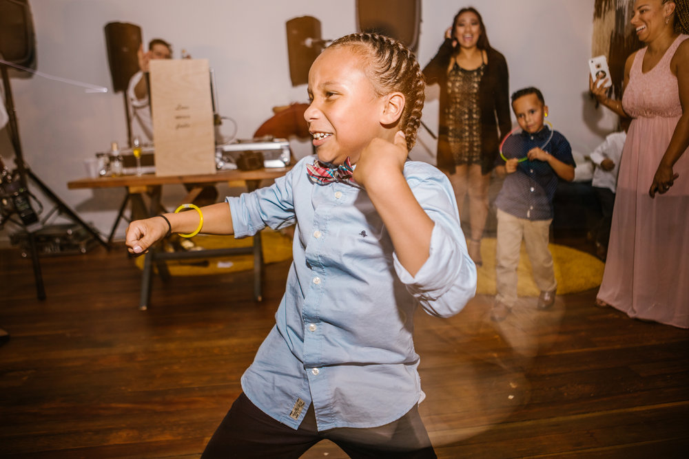 san diego wedding   photographer | kid in braids dancing