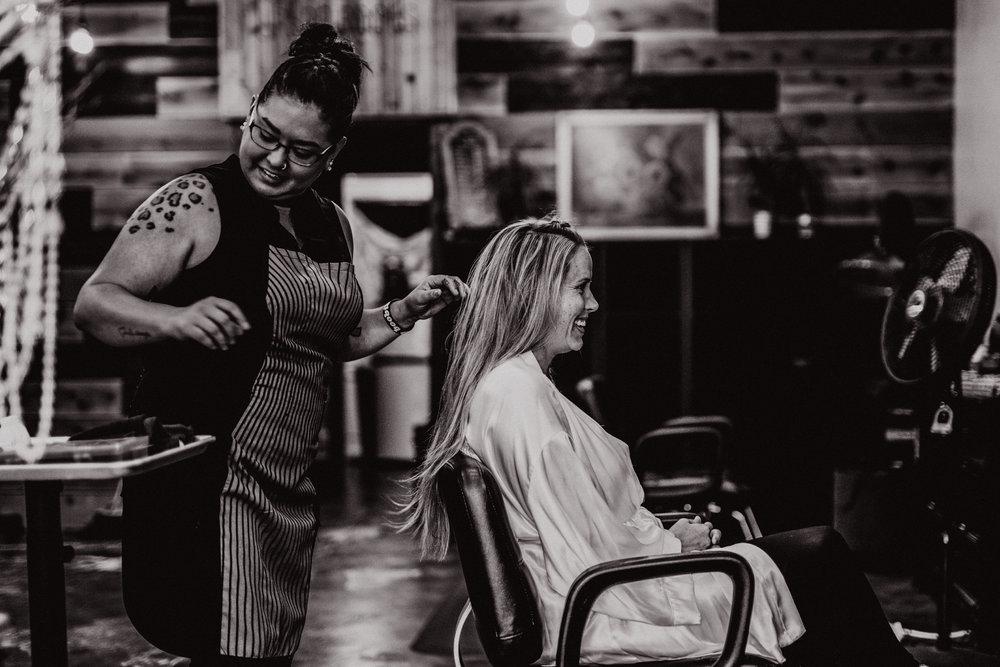 san diego wedding   photographer | woman sitting in chair getting hair done